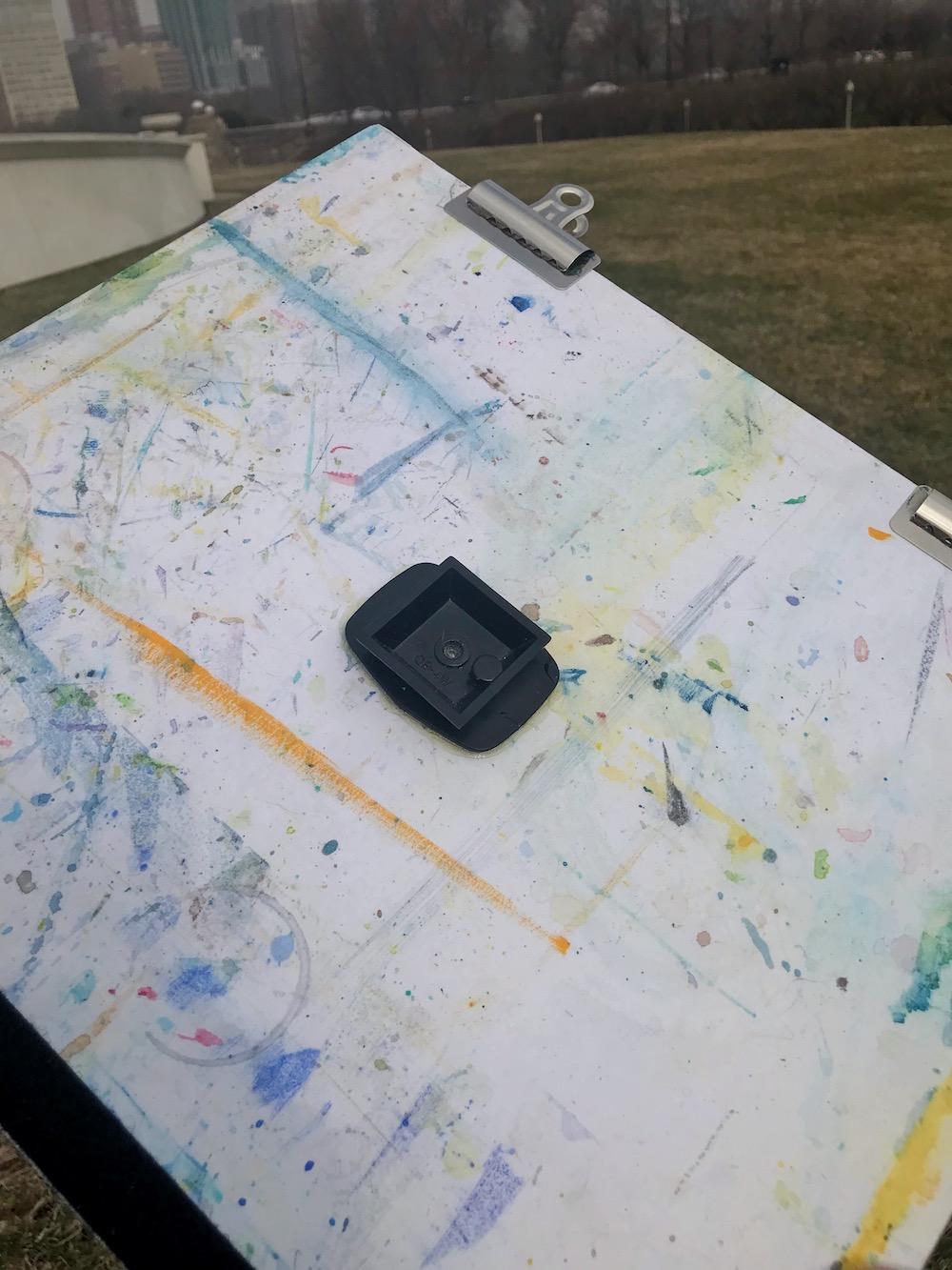 Art board fastened to tripod quick release plate